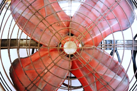 antique factory: old metal red factory fan in vintage style