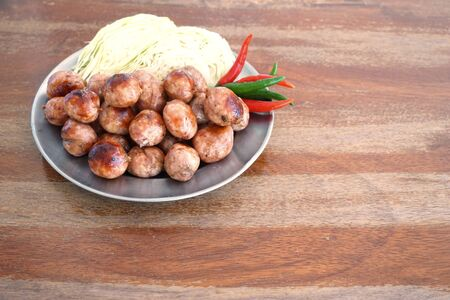 northeastern: Pork and Rice Sausage is the traditional Thai food