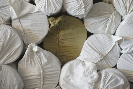 group roll of fabric stack in the factory