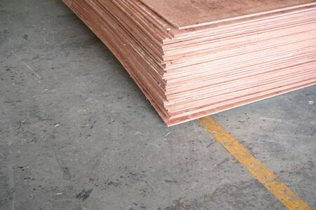 close up stack of plywood stock in the factory
