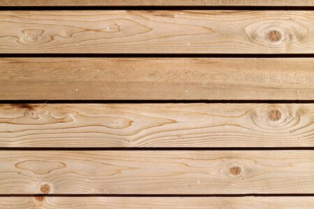material: Brown wood plank panel.