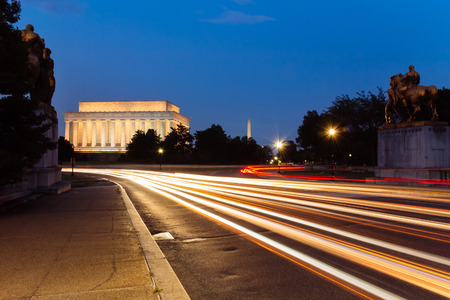 Light trail at Lincoln Memorial, seen from the Memorial bridge, Washington DC, USA.