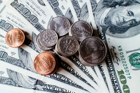onehundred: Pile of 100 US dollar banknotes and coins. Stock Photo