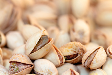 ingradient: Pile of Pistachios. Out of focus background. Stock Photo