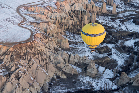 goreme: Hot air balloons fly over Cappadocia in winter, Goreme, Turkey.