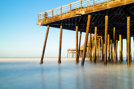 old pier: Old pier on the beach,Pismo beach, CA, USA.