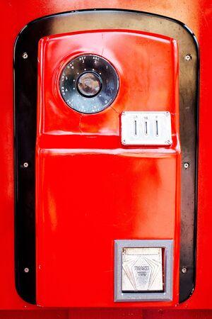 vintage telephone: Vintage red telephone on white background.