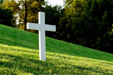 White cross on green lawn.