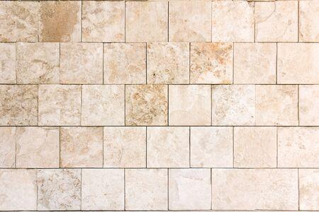 White tiles stone wall texture.