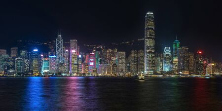 Colorful panoramic view of Hong Kong skyline on night time seen from Kowloon. Hong Kong, China.