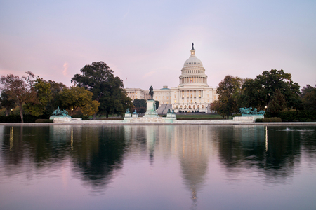 The United States Capitol Building, seen from reflection pool on dusk. Washington DC, USA. Stock Photo