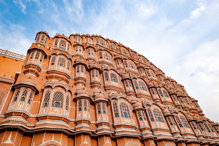 Hawa Mahal on a sunny day, Jaipur, Rajasthan, India. An UNESCO World heritage. Beautiful window architectural element. Stock Photo