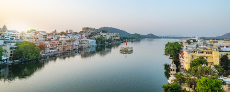 Udaipur city at lake Pichola in the morning, Rajasthan, India. View of City palace reflected on the lake. Stock Photo - 101891821