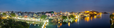 Udaipur city at lake Pichola in the evening, Rajasthan, India. View of City palace reflected on the lake. Stock Photo