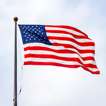 The United States of America flag on a sunny day.