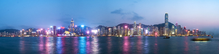 Panorama view of Hong Kong skyline on the evening seen from Kowloon, Hong Kong, China.