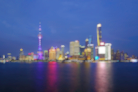 Out of focus of  Shanghai city skyline Pudong side looking through Huangpu river on twilight time. Shanghai, China. Beutiful vibrant panoramic image.