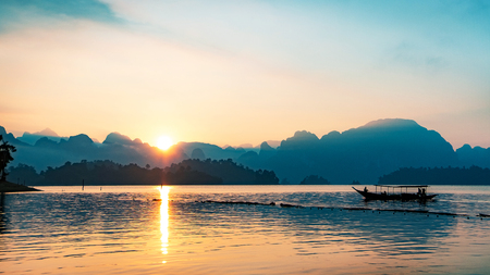 silhouette image of a boat sailing in a dam in southern of Thailand in the morning. Reklamní fotografie