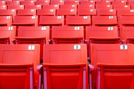 Row of red folding chairs in a stadium. Sport concept. 写真素材