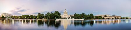 Panorama view of the United States Capitol building reflected on the reflection pool when sunset at nation mall, Washington DC, USA. 免版税图像 - 129606560