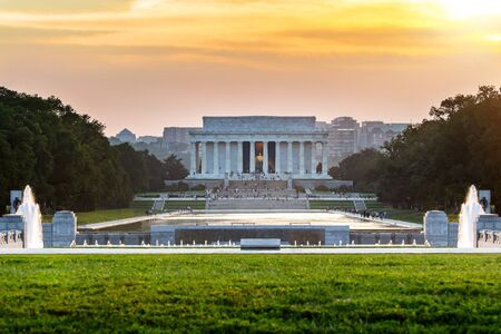 Lincoln memorial reflected on the reflection pool when sunset at nation mall, Washington DC, USA.