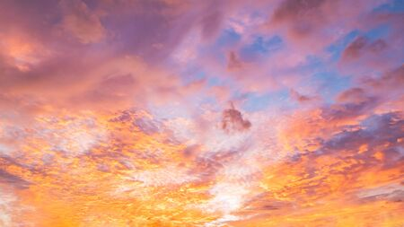 Dramatic vibrant color with beautiful cloud of sunrise and sunset on a cloudy day. Panoramic image. 写真素材