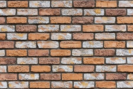 Closed up orange brick wall texture. Architectural material construction.
