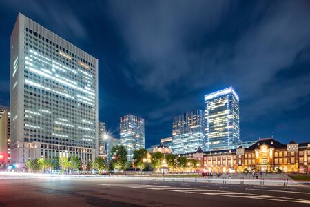 Tokyo city skyline at railway station surround by modern highrise building at twilight time.  Tokyo city, Japan. 写真素材