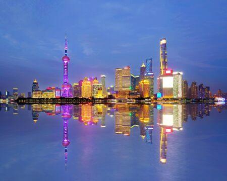Shanghai city skyline Pudong side looking through Huangpu river on twilight time. Shanghai, China. Beutiful vibrant panoramic image.