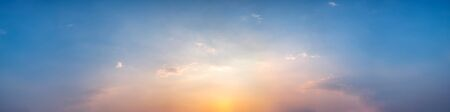 Panorama of Dramatic vibrant color with beautiful cloud of sunrise and sunset. Panoramic image. Imagens