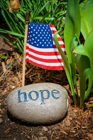 Hope message, carved on stone with USA flag 스톡 콘텐츠