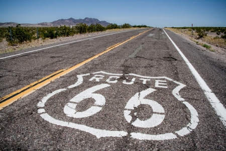 long road with a Route 66 sign painted on it photo