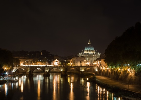 Night View of St. Peters Basilica in Vatican City, with the Tiber river and ponte Vittorio Emmanuelle II