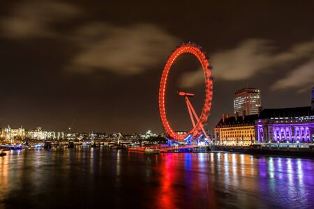 Night scene of the London Eye and Thames