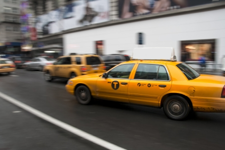 Busy streets and a yellow taxi