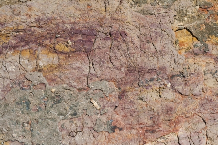 Rock texture with magenta and orange colors