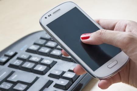 Female hands using Smartphone  photo