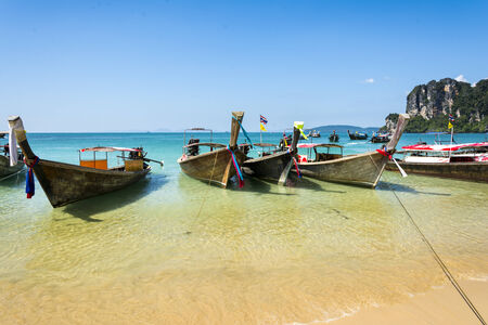 Longtail boats in Railay beach on the Andaman sea water  Krabi peninsula in Thailand photo