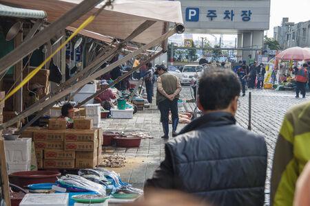 fish vendor: Busan, South Korea - October 22, 2012: People walking at Jagalchi Fish Market.