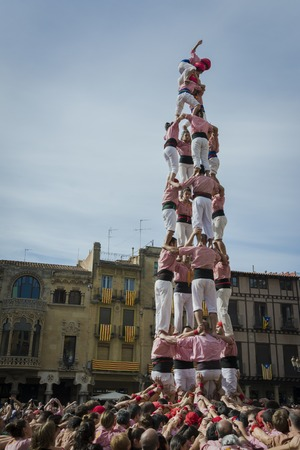 REUS, SPAIN - OCTOBER 10, 2014: Castells Performance, a castell is a human tower built traditionally in festivals within Catalonia. This is also inscribed on the UNESCO Representative List of the Intangible Cultural Heritage of Humanity Editoriali