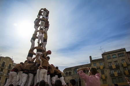 REUS, SPAIN - OCTOBER 10, 2014: Castells Performance, a castell is a human tower built traditionally in festivals within Catalonia. This is also inscribed on the UNESCO Representative List of the Intangible Cultural Heritage of Humanity 에디토리얼