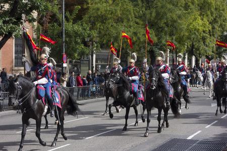 cavalry: MADRID, SPAIN - OCTOBER 12: Spanish Royal Guard cavalry (Guardia Real) on the Spanish National day or Dia de la hispanidad (hispanity day)