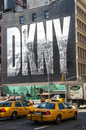 NEW YORK CITY, USA - MAY 17: 2008.Iconic DKNY Ad on Houston Street. The brick wall of the building bordering the lot has been used as a billboard for much of this time, home to the  iconic DKNY advertisement since 2009. Editorial