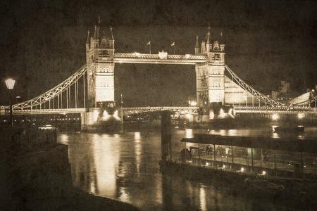 london tower bridge: Night view in Tower Bridge, London (UK). Picture in retro vintage style.