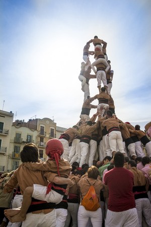 REUS SPAIN  OCTOBER 25 2014: Castells Performance a castell is a human tower built traditionally in festivals within Catalonia. This is also on the UNESCO Intangible Cultural Heritage of Humanity