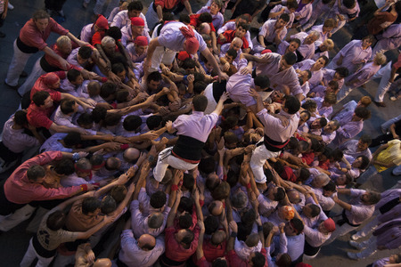 REUS, SPAIN - OCTOBER 3, 2009: Castells Performance, a castell is a human tower built traditionally in festivals within Catalonia. This is alsoon the UNESCO Intangible Cultural Heritage of Humanity Editoriali