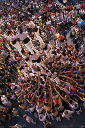 REUS, SPAIN - OCTOBER 3, 2009: Castells Performance, a castell is a human tower built traditionally in festivals within Catalonia. This is alsoon the UNESCO Intangible Cultural Heritage of Humanity 에디토리얼