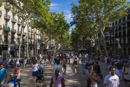 ramblas: Barcelona, Spain- July 25: Famous street La Rambla in Barcelona, Spain. Thousands of people walk daily by this popular pedestrian area 1.2 kilometer long.