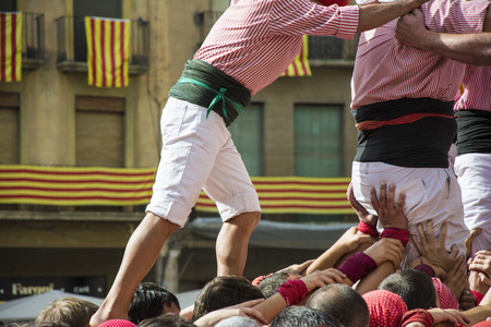 intangible: REUS, SPAIN - OCTOBER 25, 2014: Castells Performance, a castell is a human tower built traditionally in festivals within Catalonia. This is also on the UNESCO Intangible Cultural Heritage of Humanity