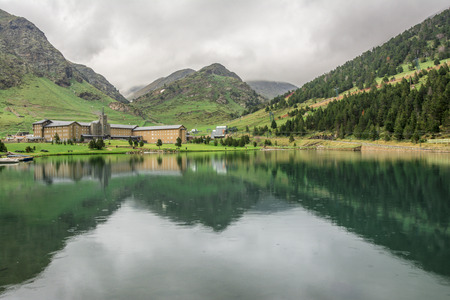 Nuria Sanctuary reflected on the lake in the catalan pyrenees.Spain